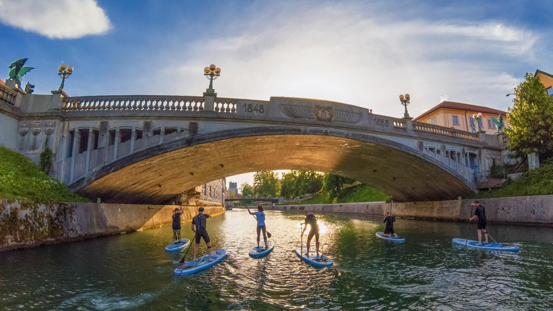 Dragon bridge and paddleboarding through the centre of Ljubljana, Slovenia